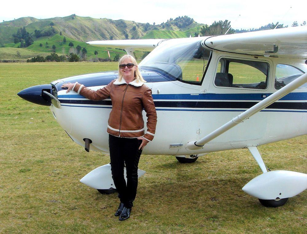 Fiona Ritchie, leather artisan at Sparrowhawk Leather with ZK-FNT 1964 Cessna 172