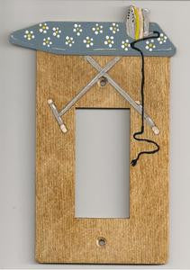 Ironing board rocker switch plate cover