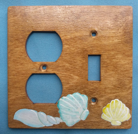 Seashell switch and plug left combination switch plate cover