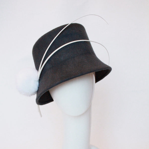 Grey cloche with ivory quills
