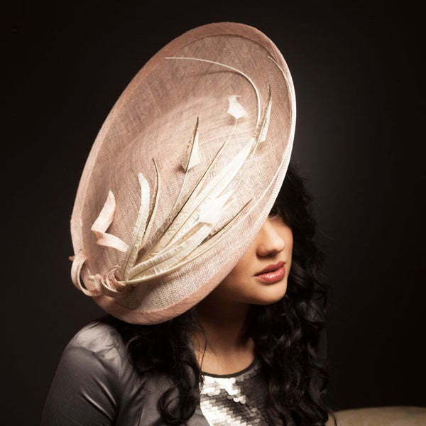 Dusty pink large hat with feathers, mother of the bride bristol. Royal Ascot