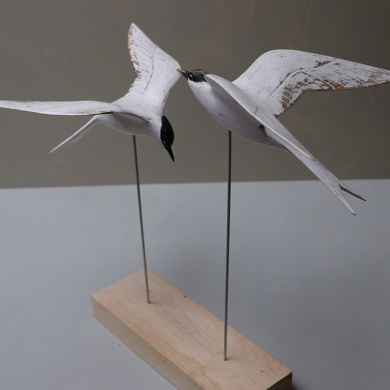 Carved wooden birds - E A R T H W O R K S