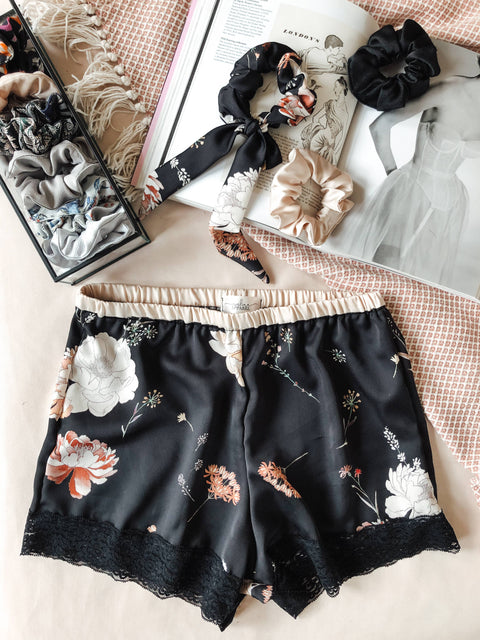 Evelina Apparel - Black floral satin shorts with lace