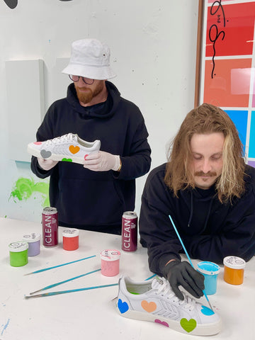 Artists Customizing a Pair of Sneakers in Celebration of Addiction Recovery