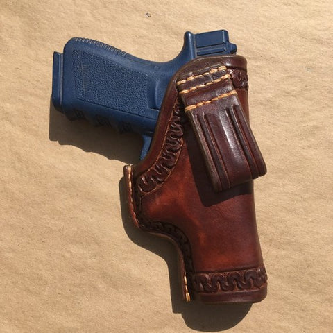 Holster for a Glock 19/23/32..... Traditional OWB Style..... Saddle Leather.....Handtooled..... Handstitched.