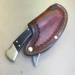 "The ""One-Hander"" Knife Sheath... One Hand Opening.. Light Brown Oil Dye…Sunburst Border Tooling... Horizontal Carry..... For The Buck 110 Folding Hunter Knife."