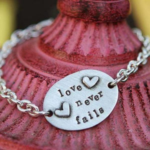 The Vintage Pearl Hand-Stamped Pewter Scripture Verse Bracelet | Love Never Fails