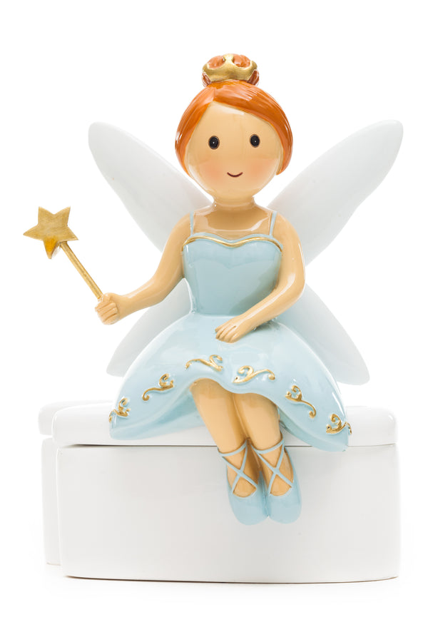 Blue dress tooth fairy seating on tooth box