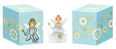 Blue dress tooth fairy seating on tooth box - Little Drops of Water