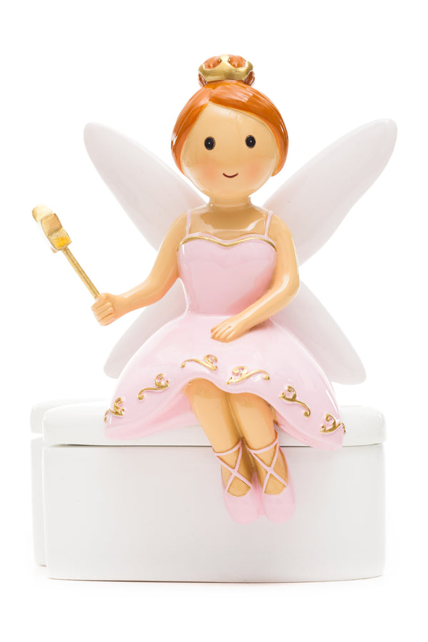 Pink dress tooth fairy seating on tooth box