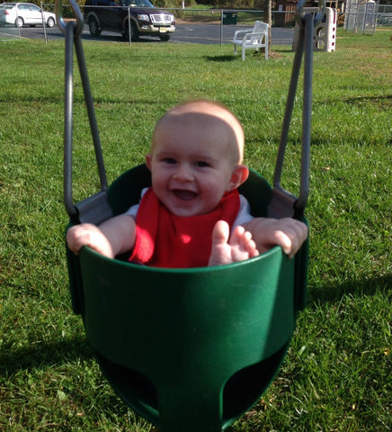 Adorable Kid in Bucket Swing