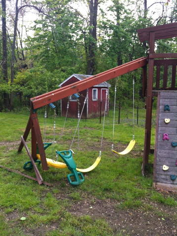 a broken and cheap swing set