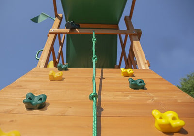 Gorilla-Playsets-Outing-W-Trapeze-Bar-Wooden-Swing-Set-Rock-Wall-Close-Up