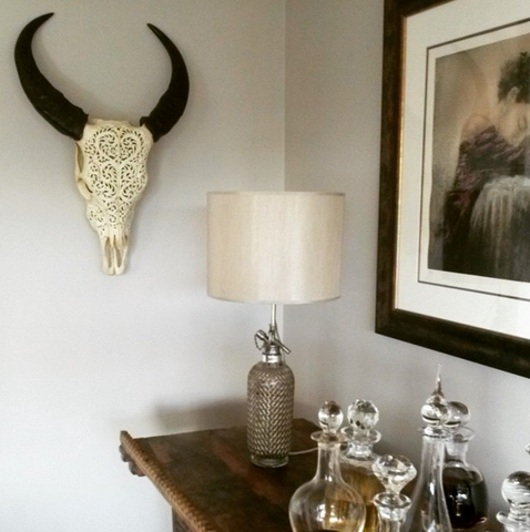 cow skull on the living room wall