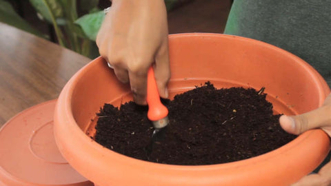slightly turning the layers - kitchen composter