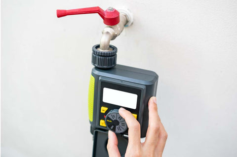 automated timer fixed to drip system