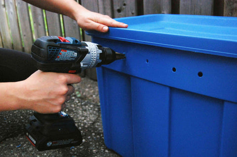 drilling holes on the side of the vermicompost bin