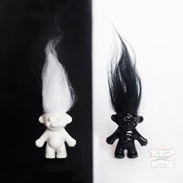 Black and white troll doll pin