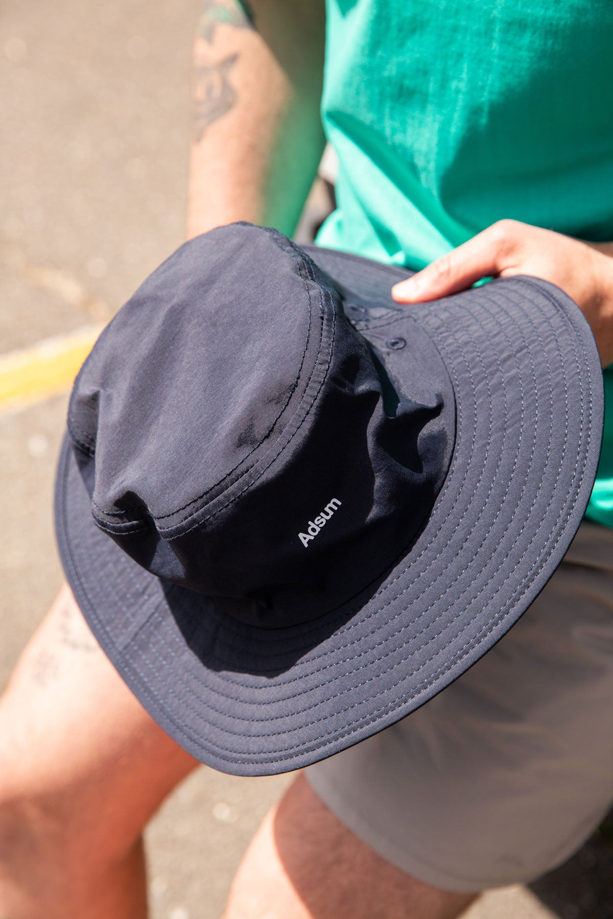 Adsum Navy Bucket Hat in Hand
