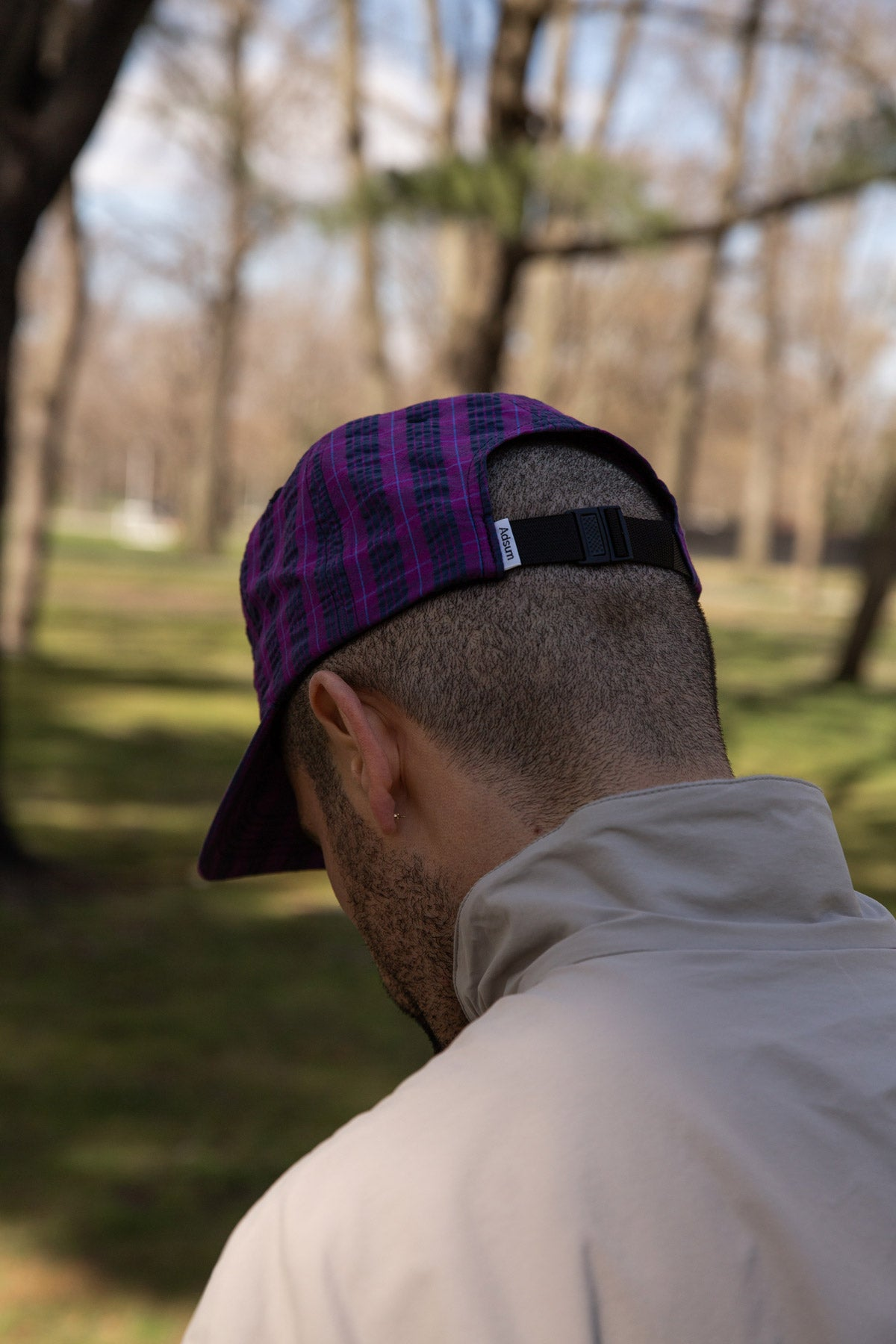 Adsum Purple Plaid hat on head