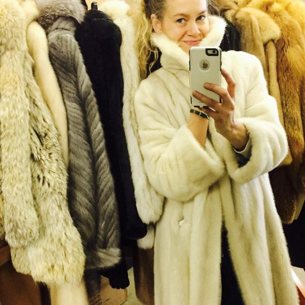 Sullivan surrounded by second hand furs in her Queen Street West shop