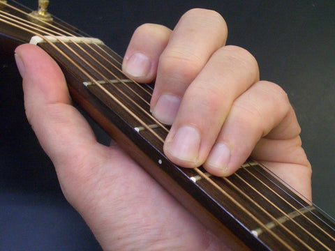 Fingers on guitar