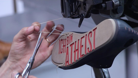 Atheist shoe sole being hand-stitched.