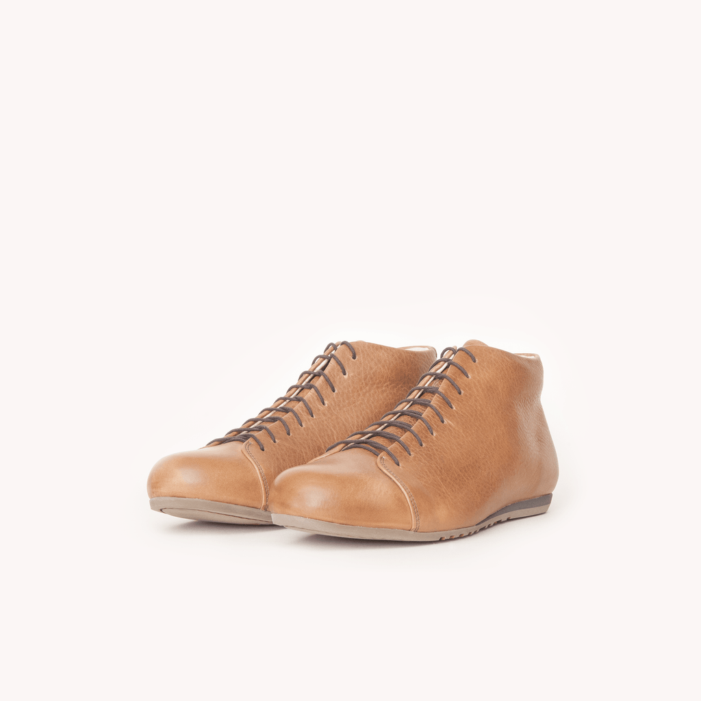 Atheist shoes - slanted view of Das Cognac Boot. Ridiculously comfortable pull up leather boots, designed in Berlin and handmade in Portugal.