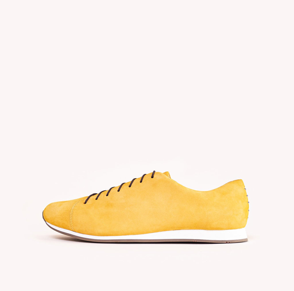 Atheist shoes - side view of Das Sneaker Honey Ochre. Ridiculously comfortable leather sneakers, designed in Berlin and handmade in Portugal