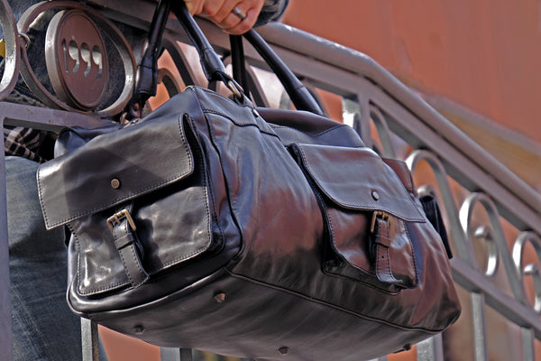 Handmade in Italy black leather duffel bag