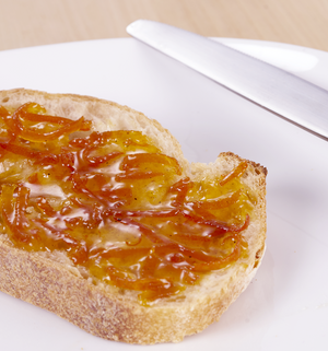 Cardamom Knows Zest | seville orange marmalade with cardamom | plate | knife | bread | toast