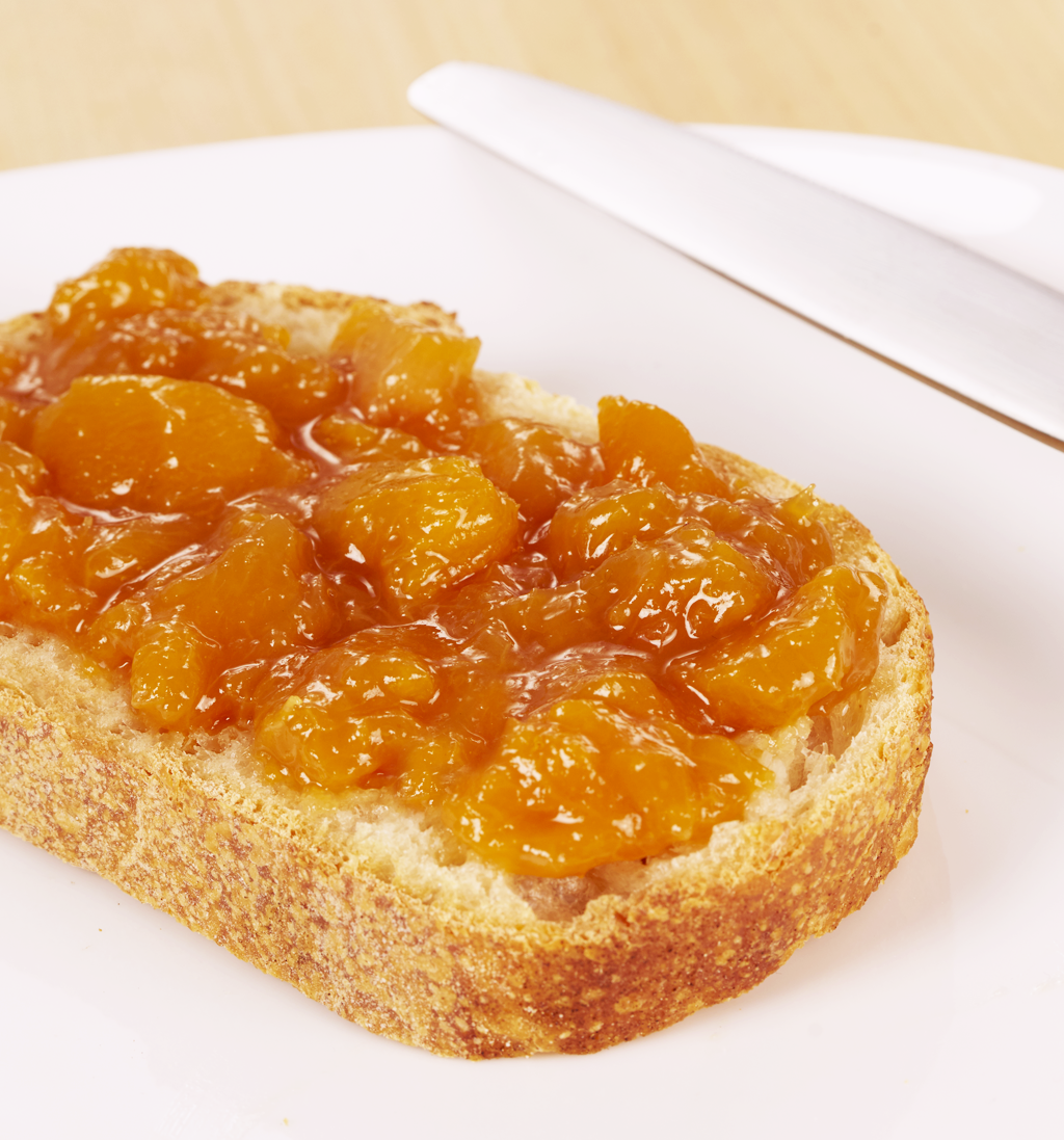 To Peach His Own, june lady peach with orange blossom essence, jam on bread toast with knife on plate