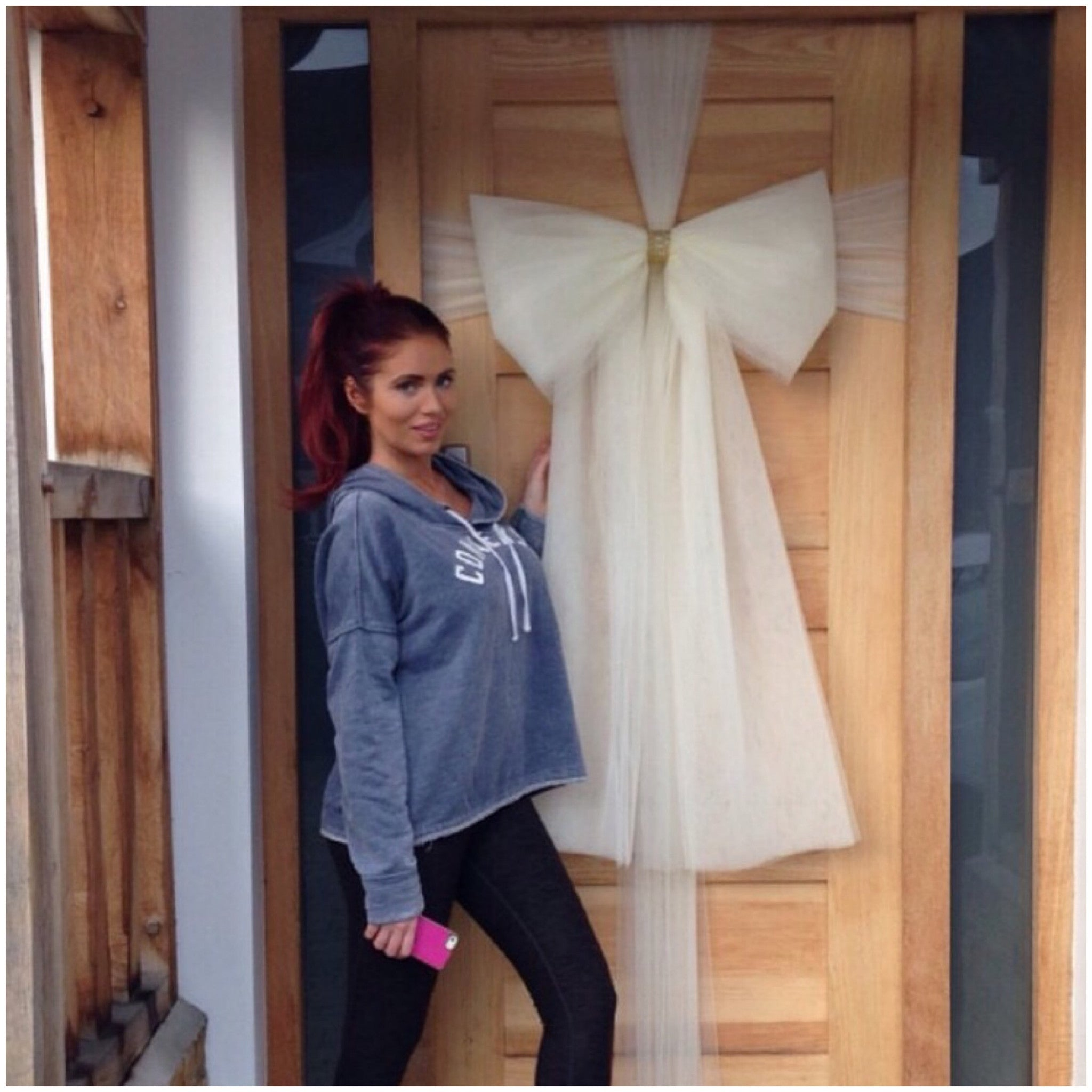 """Shut Up!"" - Essex babe Amy Childs'   dresses her door"