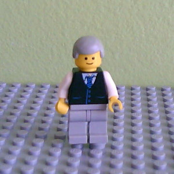 LEGO Minifigure-Black Vest with Blue Striped Tie, Light Bluish Gray Legs, White Arms, Light Bluish Gray Male Hair, Smile-Town-TWN041-Creative Brick Builders