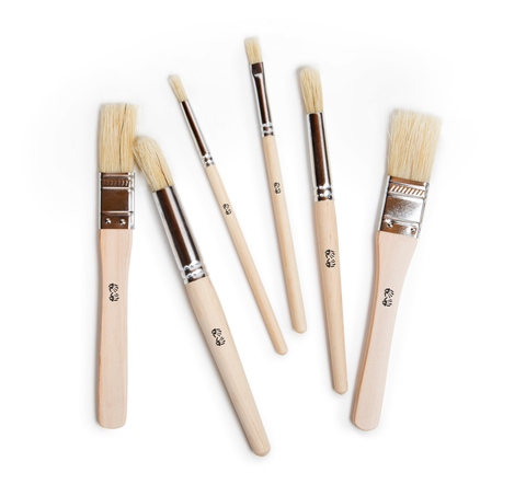 Natural wood and stainless steel paintbrushes in assorted sizes for children decorated with black handprints
