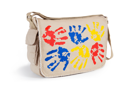 Beige frayed edge messenger bag featuring six large handprints in primary colors