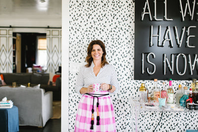Founder and CEO Katie Kime in her house in Austin Texas. Featuring the classic wallpaper Seeing Spots.