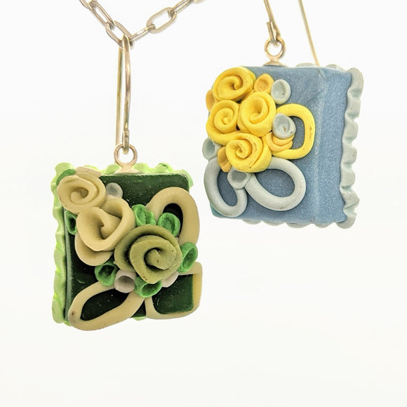 Blue and green dollhouse cake earrings