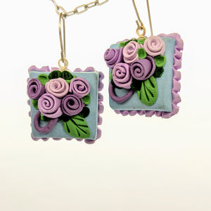 Blue and lavender dollhouse cake earrings