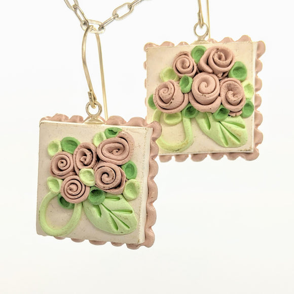 Pale pink dollhouse cake earrings