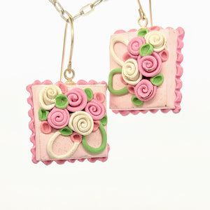 Square pink dollhouse cake earrings
