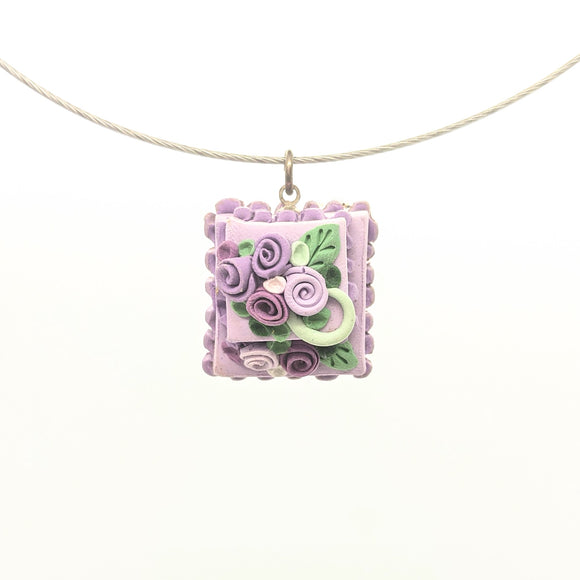 Tiered lavender dollhouse cake pendant necklace on steel cable