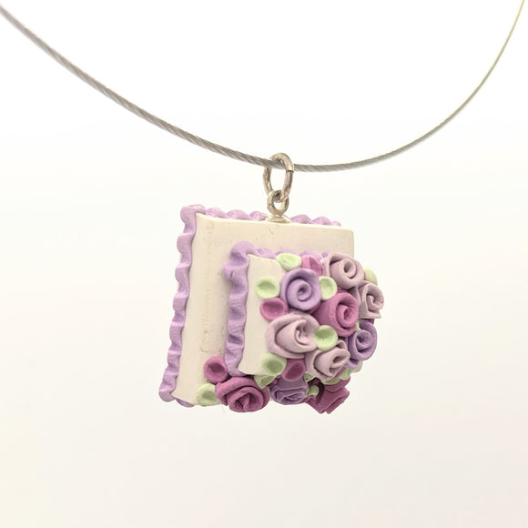 Pink and lavender dollhouse cake pendant necklace on steel cable