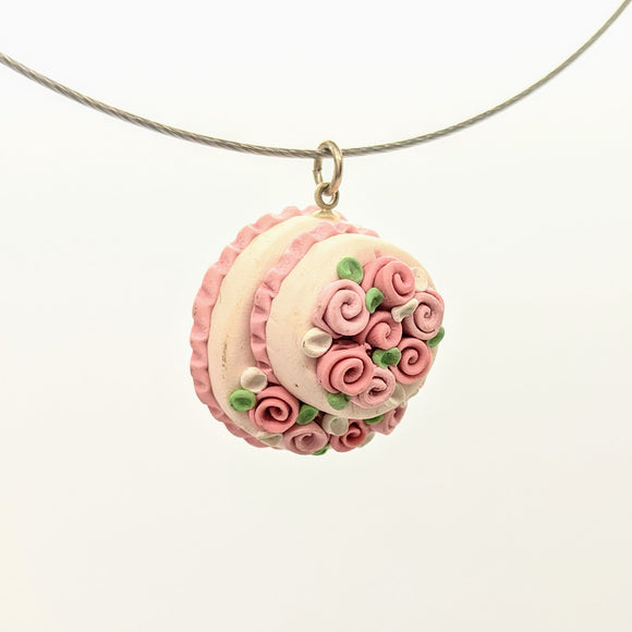 Pink dollhouse cake pendant necklace on steel cable