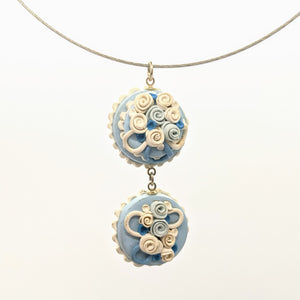 Blue and white double dollhouse cake pendant necklace on steel cable