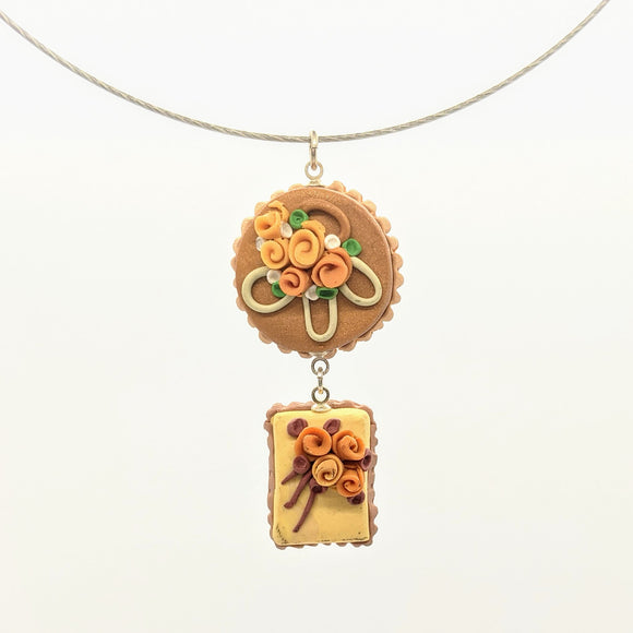 Brown and yellow double dollhouse cake pendant necklace on steel cable