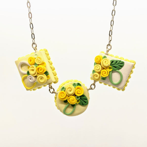 Triple yellow dollhouse cake necklace