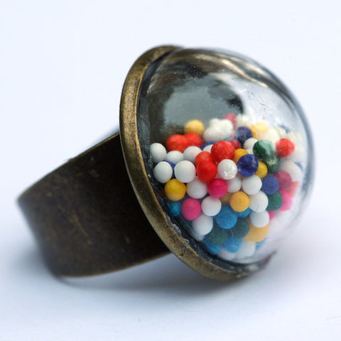 Large glass dome ring with cake sprinkles