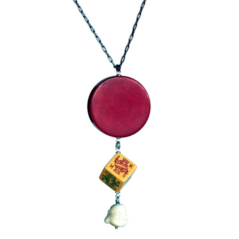 Bakelite game piece, poker die and Buddha necklace