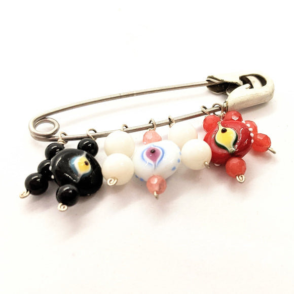 Black, white and red evil eye diaper pin